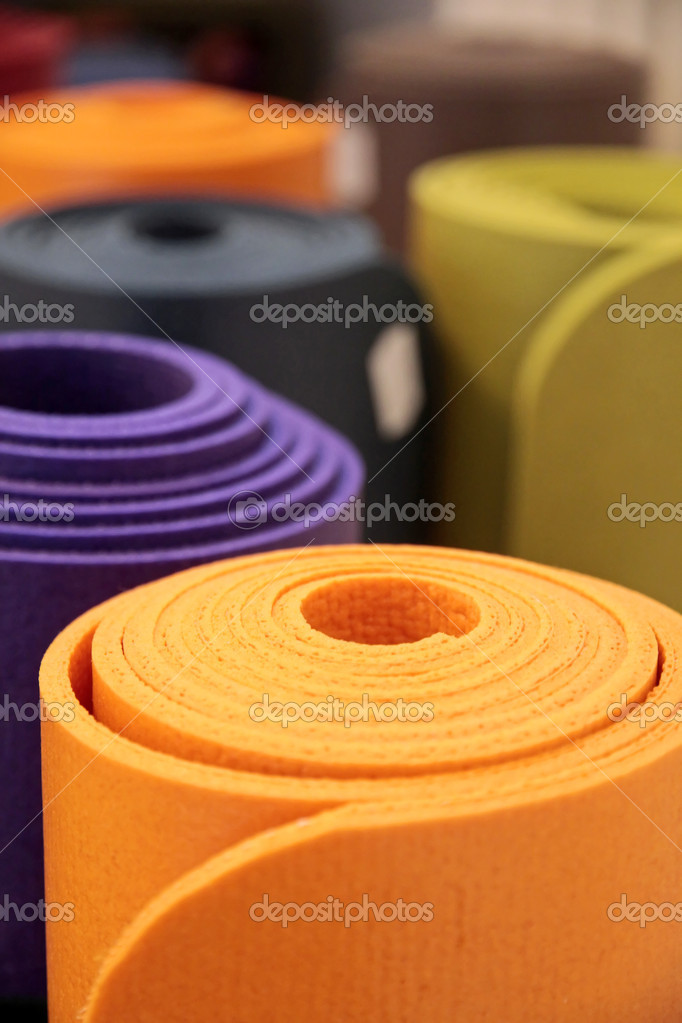 Colorful yoga mats rolled up in a yoga school — Stock Photo #5224856