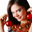 Girl wearing Christmas decorations — Stock Photo