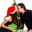 Foto Stock: Couple by Christmas tree