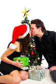 Couple by Christmas tree — Stock Photo