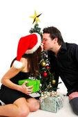 Couple by Christmas tree — Stock Photo