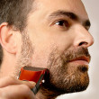 Stock Photo: Mshaving facial hair