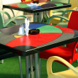 Colored Tables and Chairs at Cafe - Stock Photo