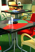 Colored Tables and Chairs at Cafe — Stock Photo