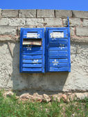 Old mailboxes hanging on the wall masonry — Stock Photo