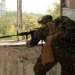 Stock Photo: The military man fired from a window