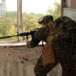 The military man fired from a window — Stock Photo