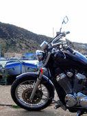 Motorcycle at embankment — Stock Photo