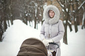 Woman with a stroller — Stock Photo