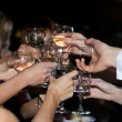 Hands with glasses of wine - Stock Photo