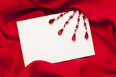 Greeting card on satin — Stock Photo