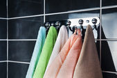Hanging bright towels — Stock Photo