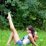 The girl having a rest in a summer garden — Stock Photo #4242988