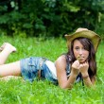 The girl having a rest in a summer garden — Stock Photo #4242992