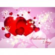 Stock vektor: Valentine card with red, orange, yellow, blue hearts.