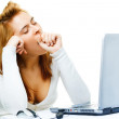 Red haired business lady over white frustrated with her computer — Stock Photo