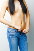 Fit woman in jeans, with naked stomach — Stock Photo