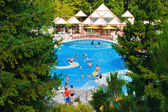 Pool and waterfall in hotel — Стоковое фото