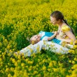 Mother with baby on yellow field — Stockfoto