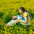 Mother with baby on yellow field — Foto Stock
