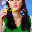 Woman blowing soap bubbles — Foto Stock
