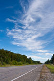 Road under skies — Stock Photo