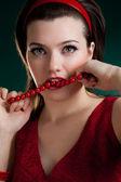 Bite the red beads — Stock Photo