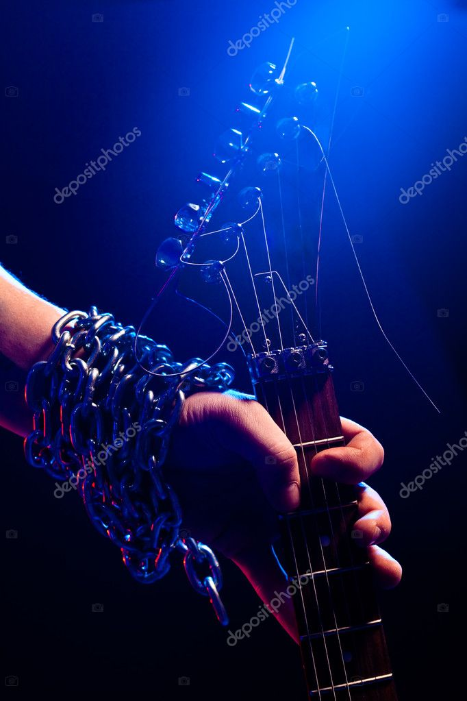 Closeup hand with guitar over blue  Stock Photo #4208669