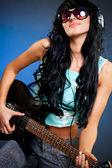 Woman holding guitar — Стоковое фото