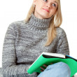 Blond woman with book — Stockfoto