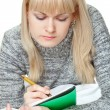 Blond woman writing — Stok fotoğraf #4415051
