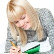 Stock Photo: Woman writing and smiling