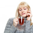 Woman with cup of tea and phone — Stock Photo