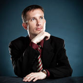 Thinking businessman portrait — Stock Photo