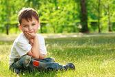 Little boy sitting on grass — Stock Photo