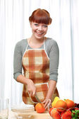 Ginger woman at kitchen — Stock Photo