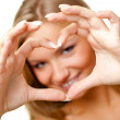 Woman showing heart symbol — Stock Photo #4611287