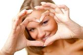 Símbolo del corazón mujer mostrando — Foto de Stock