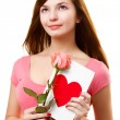 Woman dreaming with card and rose flower — Stock Photo