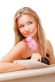 Woman writing valentine card — Stock Photo