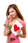 Woman with card and rose flower — Foto de Stock