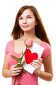 Woman dreaming with card and rose flower — Stockfoto