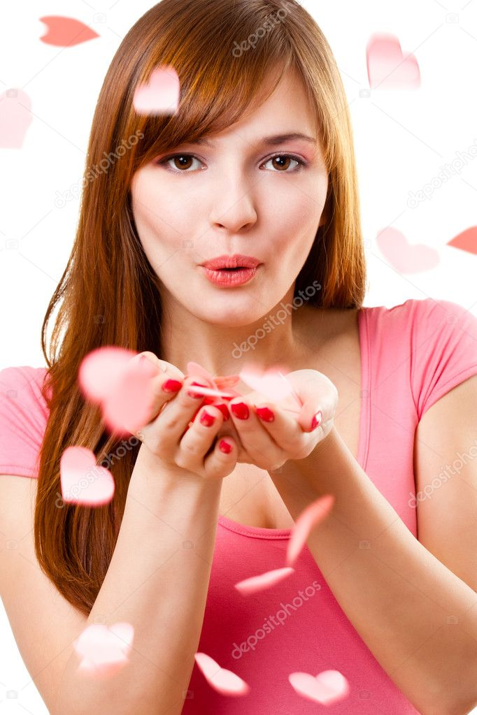 Beautiful woman blowing up kiss with hearts  Stock Photo #4642582