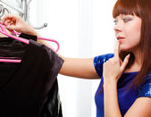 Woman finding clothes at store — Stock Photo