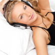 Blond woman listening the music — Stock Photo #4928717