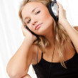 Blond woman listening the music — Stock Photo #4928724