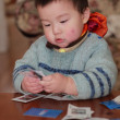 Baby playing cards — Stock Photo