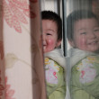 Boy hide behind curtain — Stock Photo