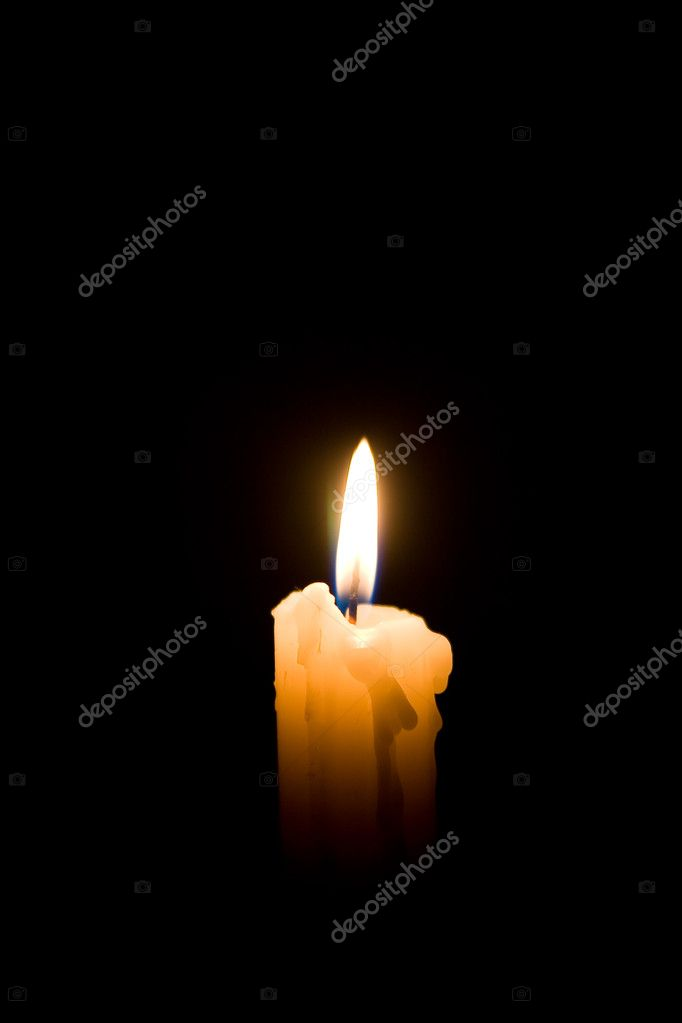 Conflagrant candle on a black background  Stock Photo #4366432