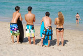 Three Surfers and a Female Admirer — Stock Photo